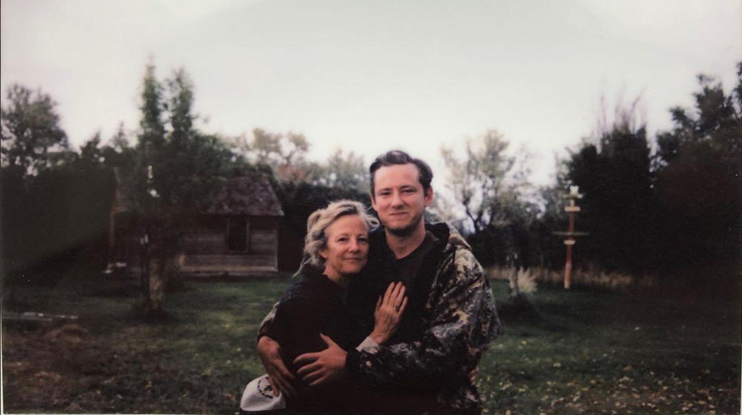 Lewis Pullman hugging his mom